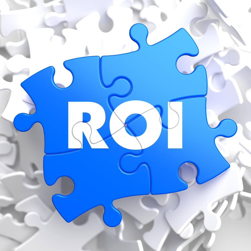 ROI - Return Of Investment - Written on Blue Puzzle Pieces. Business Concept..jpeg